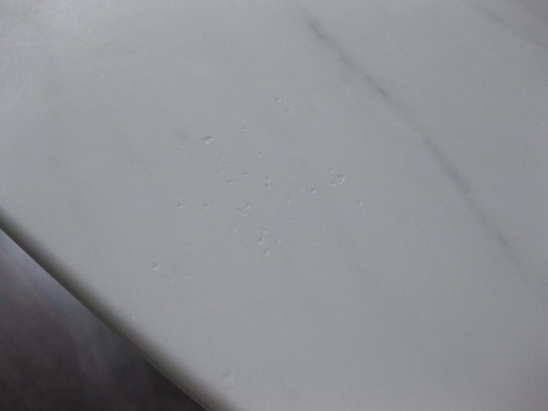 Marble dining table with predominant holes requires chip repair