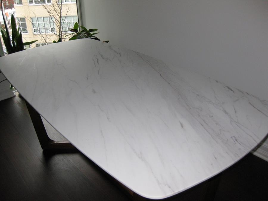 Dining table with defective acrylic coating was refinished to a uniform honed finish.