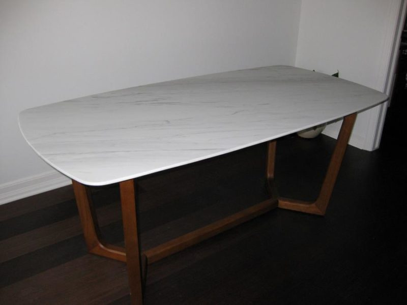 After pic of a refinished dining table with defective acrylic coating removed and polished to a honed finish to reveal the natural beauty of the white carrarra marble.